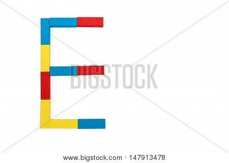 Capital letter E made up of different color wooden rectangular blocks isolated on a white background
