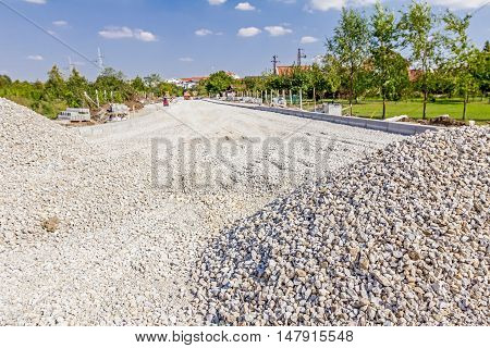 Piles of gravel at road construction view on building site
