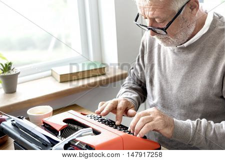 Senior Adult Typing Typerwriter Concept