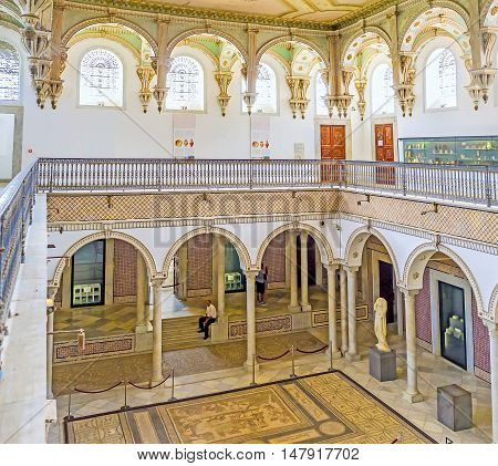 TUNIS TUNISIA - SEPTEMBER 2 2015: The view on the scenic arcades of the Carthage Room of Bardo National Museum decorated with tiles and stone pillars on September 2 in Tunis.