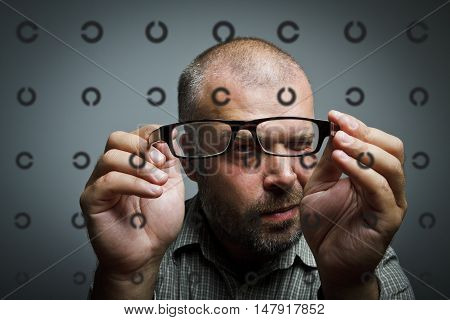 Man is looking through the glasses. Oculist Ophthalmologist Doctor Point Examination Table.