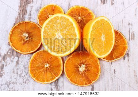 Dried And Fresh Orange On Old Wooden Background