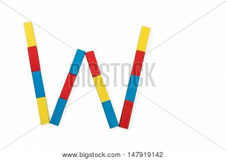 Capital letter W made up of different color wooden rectangular blocks isolated on a white background