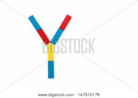 Capital letter Y made up of different color wooden rectangular blocks isolated on a white background
