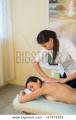 Portrait Of Female Masseuse At Health Spa.