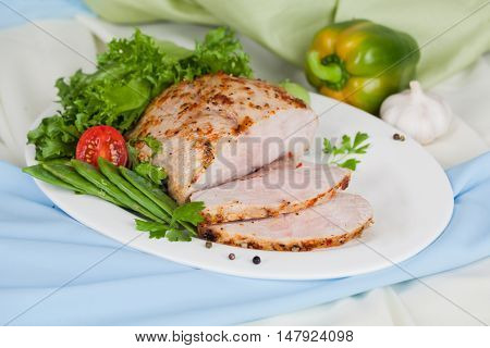 meat baked with expert on the oval dish with drapes