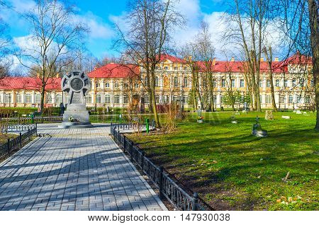 SAINT PETERSBURG RUSSIA - APRIL 25 2015: The cemetery in courtyard of St Alexander Nevsky Lavra with the monastery buildings on the background on April 25 in Saint Petersburg.