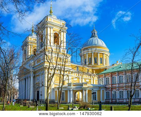 The building of Holy Trinity Cathedral decorated with the colonnade at the entrance two massive bell towers and great dome Alexander Nevsky Lavra St Petersburg Russia.