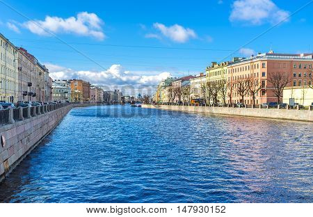 The walk along embankment of Fontanka River occupied with the beautiful palaces and mansions St Petersburg Russia.
