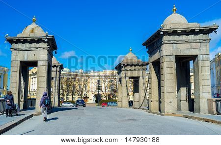 SAINT PETERSBURG RUSSIA - APRIL 25 2015: The Lomonosov Bridge consists of two broad arched side-spans and a shorter central span on April 25 in Saint Petersburg.