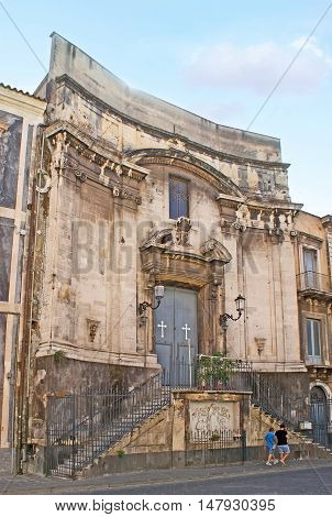 The old ruined church in Antonio Sangiuliano street with the relief of Virgin Mary in front of the staircase Catania Sicily Italy.