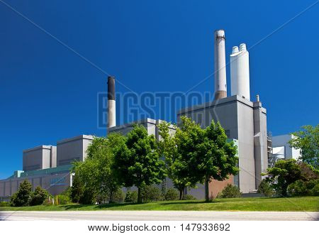 Coal fueled electricity power plant generation station building with smokestack perspective view