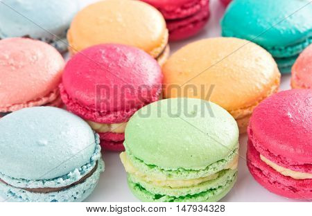 Handmade colorful macaroons close up for background