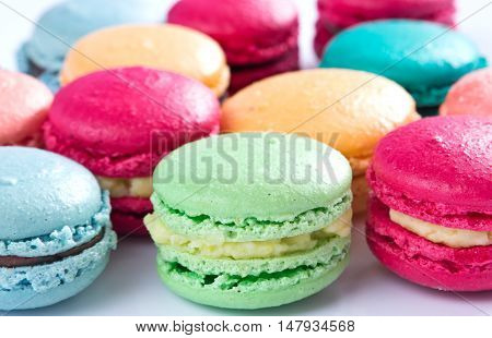 Colorful handmade macaroons over white close up