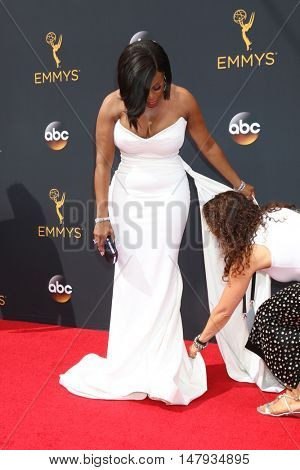 LOS ANGELES - SEP 18:  Niecy Nash, publicist Elizabeth Much at the 2016 Primetime Emmy Awards - Arrivals at the Microsoft Theater on September 18, 2016 in Los Angeles, CA