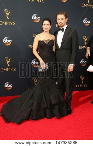 LOS ANGELES - SEP 18:  Neve Campbell, JJ Feild at the 2016 Primetime Emmy Awards - Arrivals at the Microsoft Theater on September 18, 2016 in Los Angeles, CA