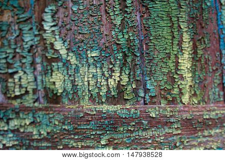 particles of old paint on a wooden surface. background