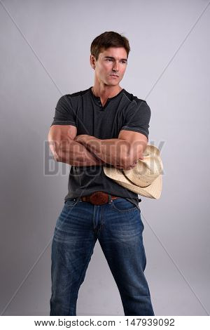 This is one good looking muscular cowboy.