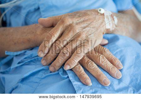 old man hand sleeping in a hospital
