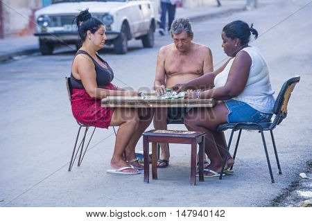 HAVANA CUBA - JULY 18 : Unidentified Cuban people play dominos on the street on July 18 2016 in Havana Cuba. Domino is one of the most popular games in Cuba