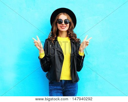 Fashion Pretty Smiling Cool Woman Wearing A Black Rock Style Over Colorful Blue Background