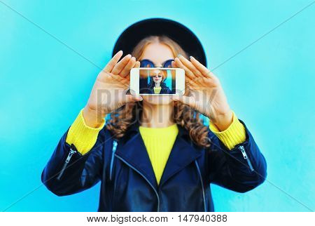 Fashion Pretty Woman Taking Photo Self Portrait On Smartphone Over Colorful Blue Background