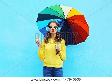 Fashion Pretty Cool Girl Listens To Music In Headphones With Colorful Umbrella In Autumn Day Over Co