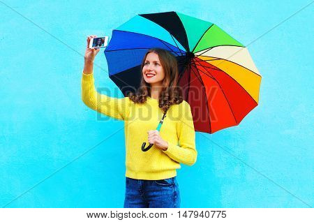 Happy Smiling Young Woman With Autumn Colorful Umbrella Taking Photo Makes Self Portrait On Smartpho