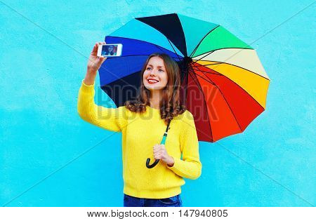Happy Smiling Young Woman With Colorful Umbrella Taking Autumn Photo Makes Self Portrait On Smartpho