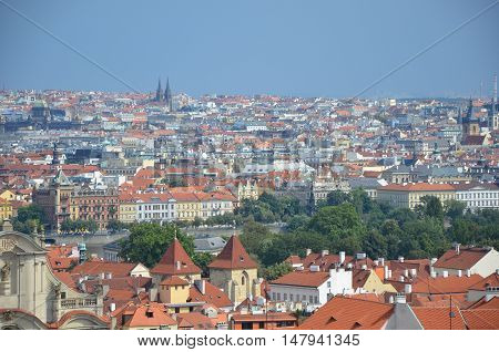 Prague red roofs in summer with blue sky