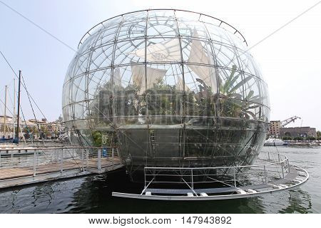 GENOA ITALY - JULY 14: Biosphere Globe in Genoa on JULY 14 2013. Tropical Greenhouse Glass Sphere Docked at Port in Genoa Italy.