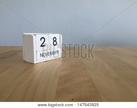 November 28Th. November 28 White Wooden Calendar On Vintage Wood Abstract Background.autumn Day.copy