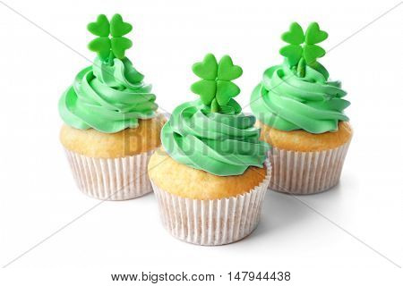 Tasty cupcakes with clover, isolated on white. Saint Patrics Day concept