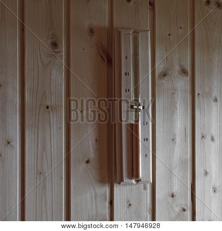 Hourglass On Wall In Sauna Room
