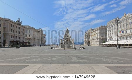 TRIESTE ITALY - JULY 15: Unity Square in Trieste on JULY 15 2013. Fountain of the Four Continents at Unity of Italy Square in Trieste Italy.