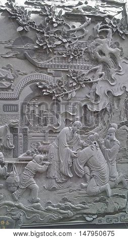 Stone detail of a Buddhist scene from a temple at Sun Moon Lake in Tawain in Asia.