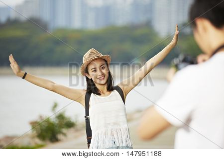 young couple tourists taking a travel photo