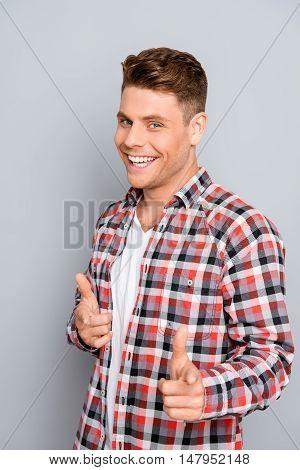 Portrait Of Happy Smiling Joyful Man Pointing On Camera