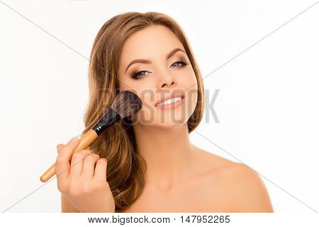 Beautiful Woman Applying Foundation Powder With Makeup Brush
