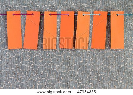 Seven Orange Rectangular Tags