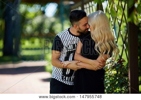 caress couple in the park blond and brown hair