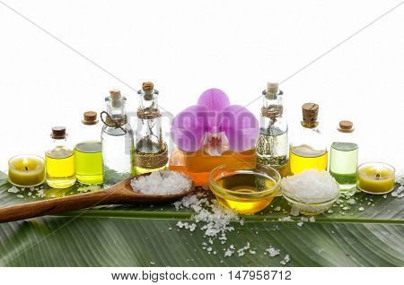 Spa set on banana leaf with pink orchid ,salt in spoon