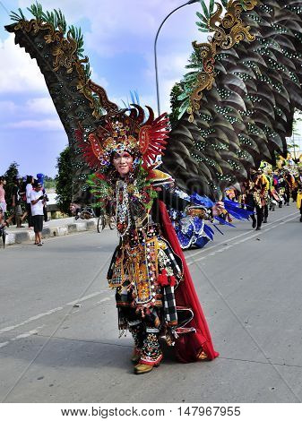 Tenggarong Indonesia - October 27th 2012: carnival with unique costumes on public roads within distance 4 km and is held every year in east borneo indonesia