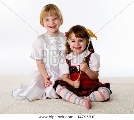 two little girls on the floor