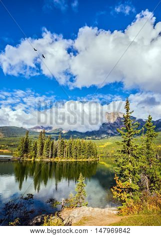 Charming little island in the Pyramid Lake. The clear autumn morning in the Rocky Mountains of Canada