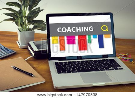 COACHING Laptop on table. Warm tone businessman work hard and use computer