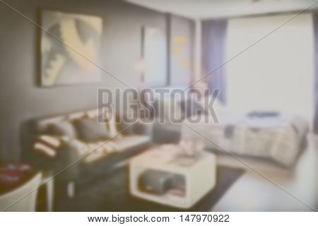 Blurred background modern bedroom interior with sofa
