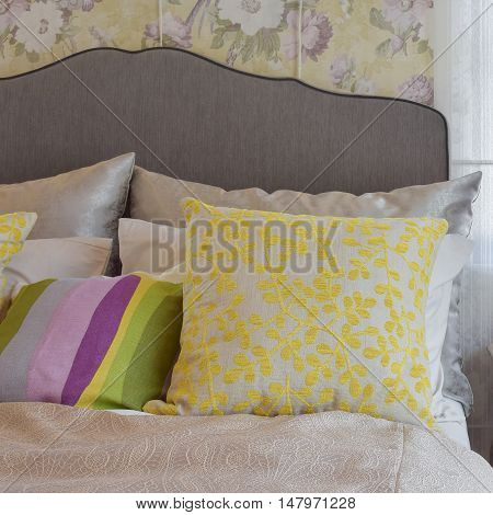 cozy bedroom interior with colorful pillow on bed