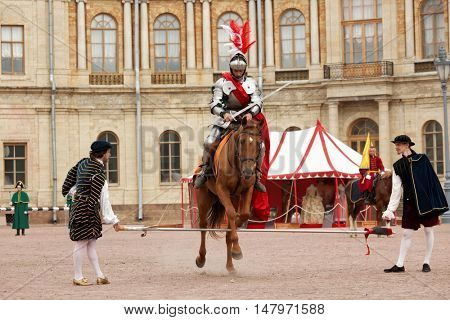 GATCHINA, ST. PETERSBURG, RUSSIA - SEPTEMBER 10, 2016: Actor in image of Emperor Nicholas I on a horse breaks the barrier in front of Gatchina palace during the festival Gatchinskaya Byl