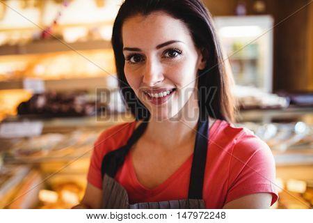 Portrait of female baker smiling in bakery shop